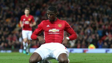 Paul Pogba celebrates after putting Man Utd three goals ahead