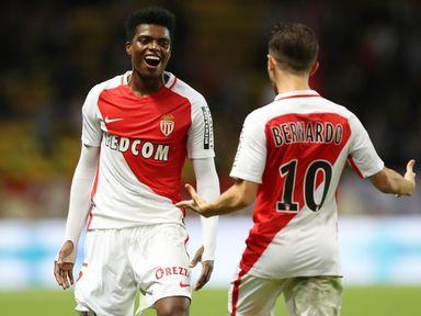 Monaco defender Jemerson (L) celebrates with Bernardo Silva after scoring