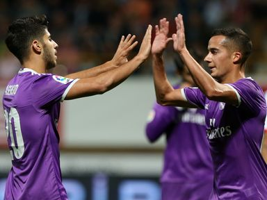 Real Madrid's midfielder Marco Asensio (L) celebrates a goal