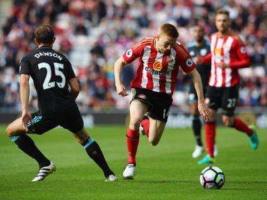 Duncan Watmore takes the ball past Craig Dawson