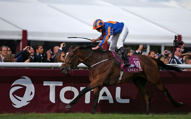 Ryan Moore celebrates after riding Found to win the Qatar Prix de l'Arc de Triomphe