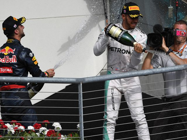 Lewis Hamilton celebrates his victory in Texas