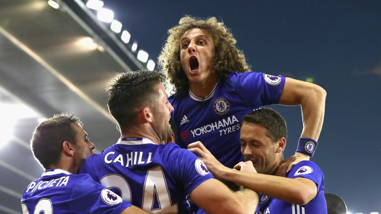 SOUTHAMPTON, ENGLAND - OCTOBER 30: David Luiz of Chelsea (C) celebrates after his team mate Diego Costa of Chelsea scores their sides second goal during th