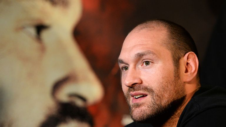 Tyson Fury speaks during a press conference ahead of his heavyweight title fight against Wladimir Klitschko