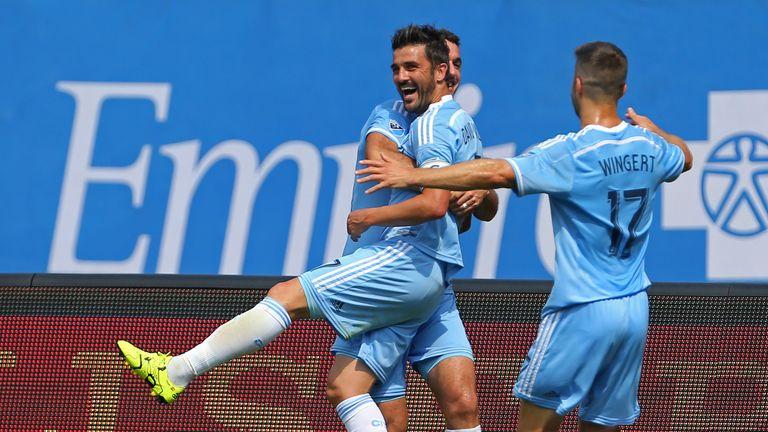 New York City FC striker David Villa (centre) celebrates after scoring against DC United