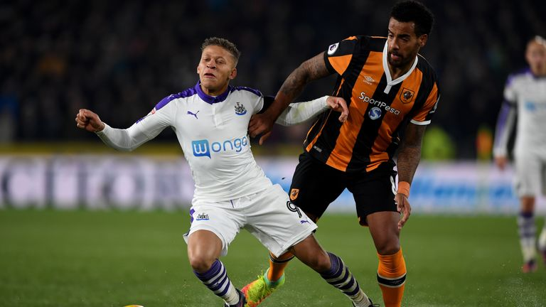 Newcastle's Dwight Gayle is challenged by Tom Huddlestone