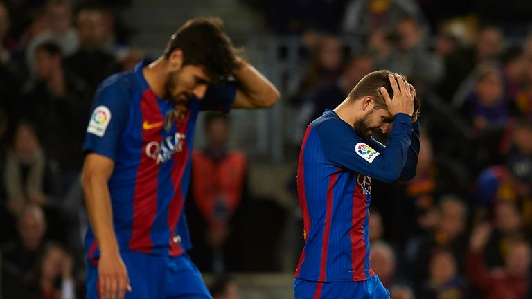 Barcelona's players, including defender Gerard Pique (right), show their frustration after the champions dropped more points at Real Sociedad on Sunday
