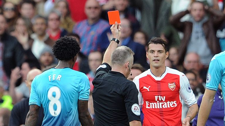 Granit Xhaka is shown a red card during Arsenal's meeting with Swansea