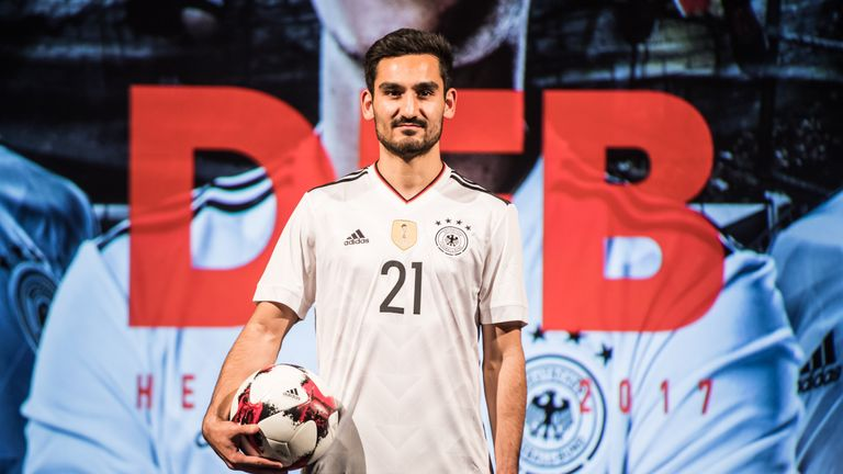 Ilkay Gundogan poses during the presentation of the new Germany home jersey