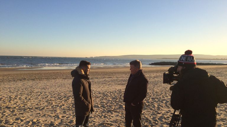 Wilshere talks to Geoff Shreeves on the beach in Bournemouth