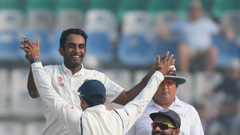 Jayant Yadav (left) took four wickets and hit his maiden test fifty in Mohali