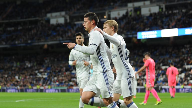 Odegaard celebrates with James Rodriguez