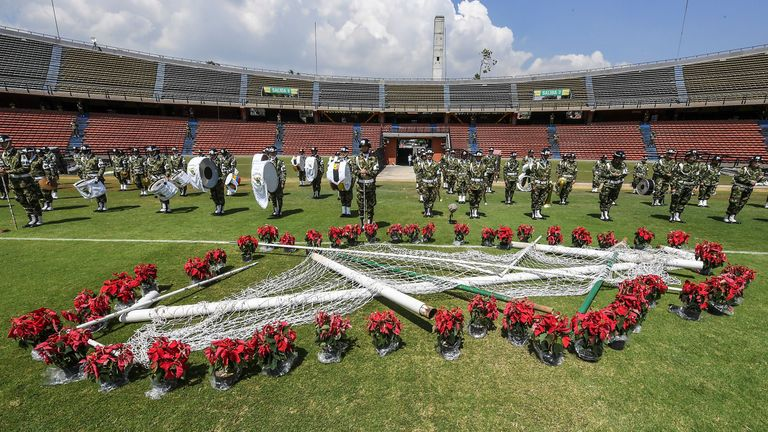 Members of the Colombian Army take part in a tribute to the victims of  the Medellin plane crash