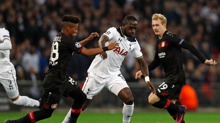 Tottenham Hotspur's French midfielder Moussa Sissoko (2nd R) vies with Leverkusen's Wendell and Julian Brandt