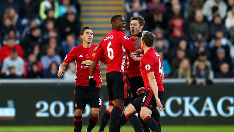 Pogba celebrates after scoring United's opener