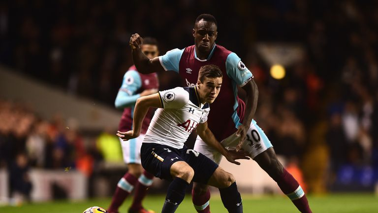 Winks of Tottenham (L) is put under pressure from West Ham's Antonio