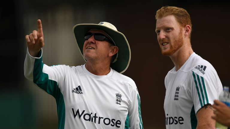 England coach Trevor Bayliss speaks with Ben Stokes at nets