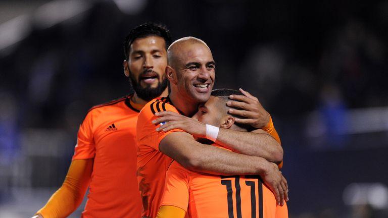 Zakaria Bakkali  (11) is congratulated after scoring for Valencia