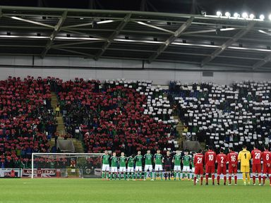 The Northern Ireland and Azerbaijan teams stand for a minutes' silence on Armistice Day