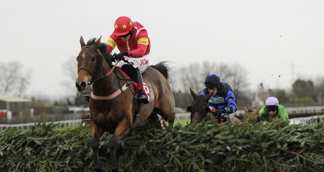 Highland Lodge and Henry Brooke jump the final fence as they win the Becher Chase in 2015.