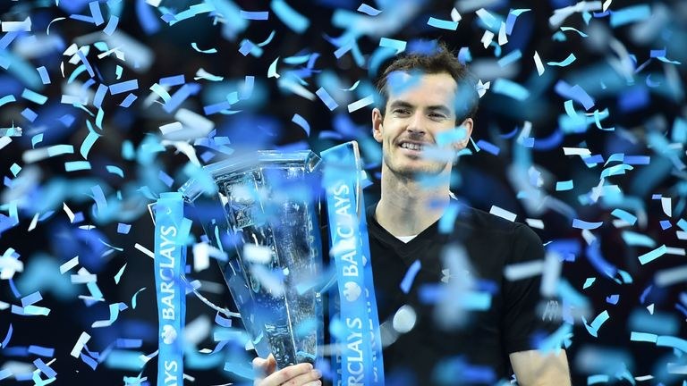 Andy Murray celebrates with the trophy after winning the men's singles final on the eighth and final day of the ATP World Tour Finals