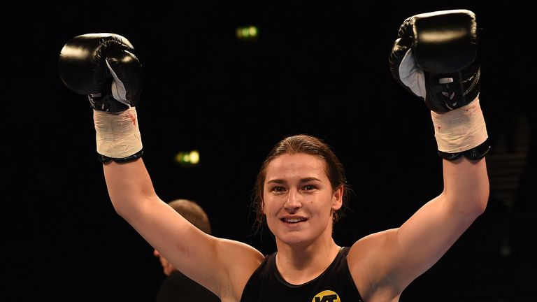 Katie Taylor celebrates her pro debut win