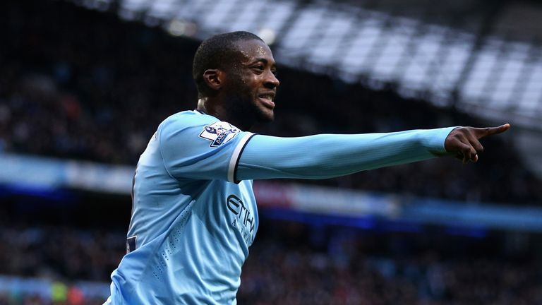 MANCHESTER, ENGLAND - FEBRUARY 22:  Yaya Toure of Manchester City celebrates scoring the opening goal during the Barclays Premier League match between Manc