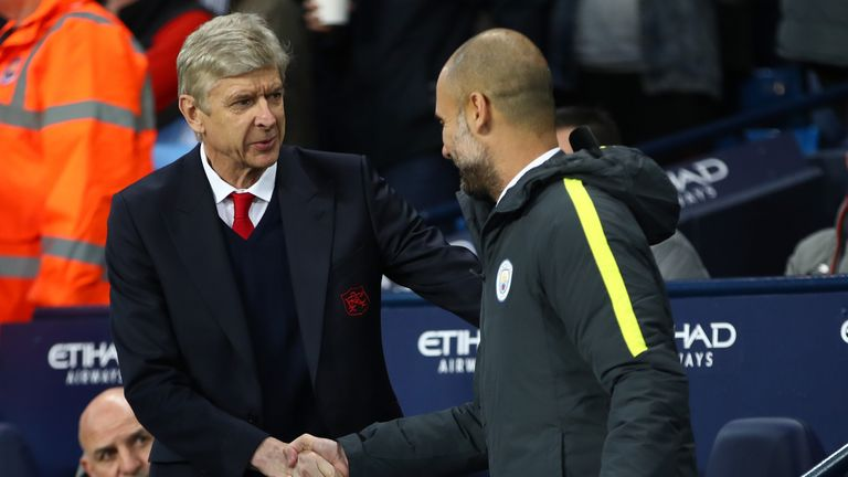 Wenger shakes hands with Pep Guardiola before the game