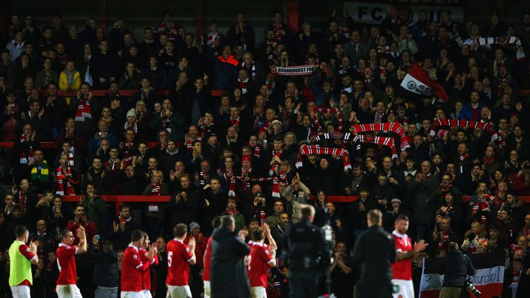 FC United of Manchester players and fans applaud each other after the FA Cup first round match against Chesterfield