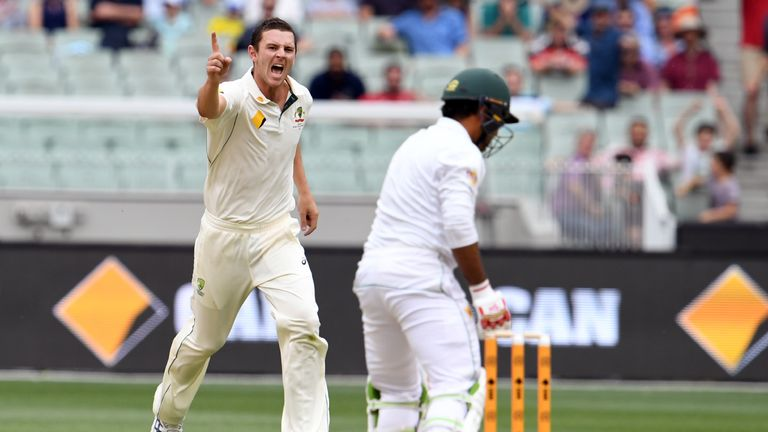 Australia's Josh Hazlewood (L) celebrates the wicket of Pakistan batsman Sarfraz Ahmed (R)