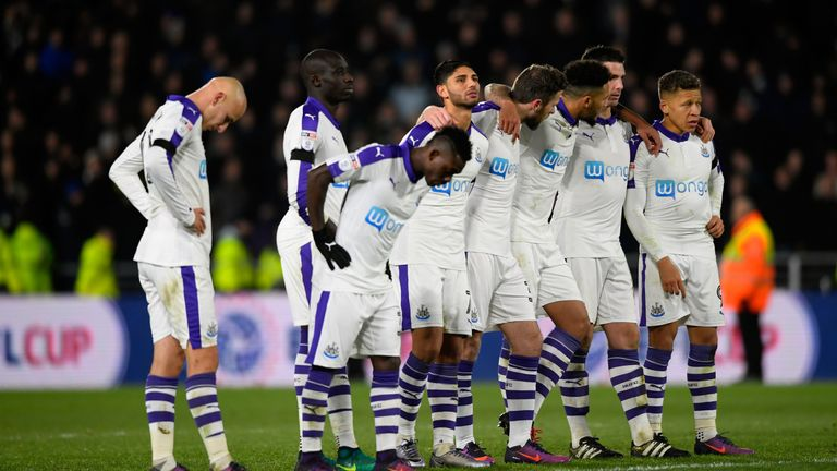 The Newcastle players watch on during the penalty shootout against Hull City