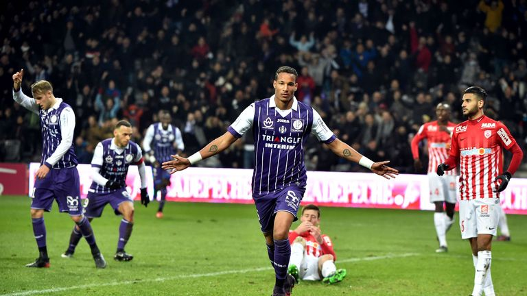 Toulouse's forward Christopher Jullien (C) celebrates after scoring against Nancy