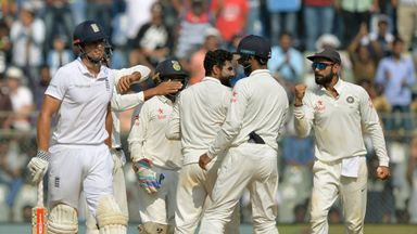 India celebrate Alastair Cook's wicket on day four of the fourth Test in Mumbai (Credit: AFP)