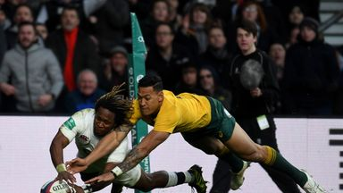Marland Yarde (L) scores for England, despite the attentions of Israel Folau  (R)