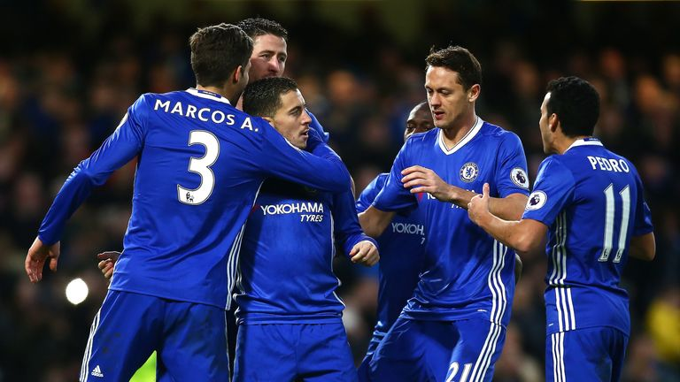 Eden Hazard, surrounded by his Chelsea team-mates, celebrates after extending Chelsea's lead at Stamford Bridge