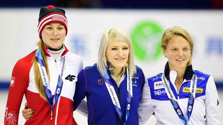 Elise Christie (centre) has claimed her second gold of the weekend