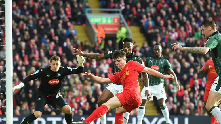 Ben Woodburn (centre) has an effort on goal for Liverpool against Plymouth