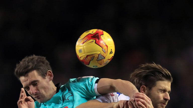 Derby's Craig Bryson and Leeds' Gaetano Berardi battle for the ball
