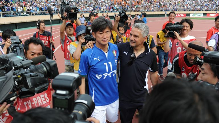 Japanese striker Kazuyoshi Miura, 49, seen here on the left next to Roberto Baggio, has signed a new deal