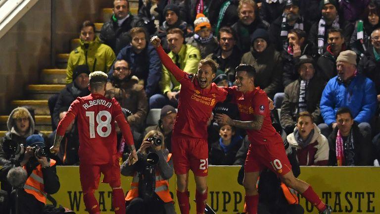 Liverpool's Brazilian midfielder Lucas Leiva (C) celebrates with teammates after scoring the opening goal