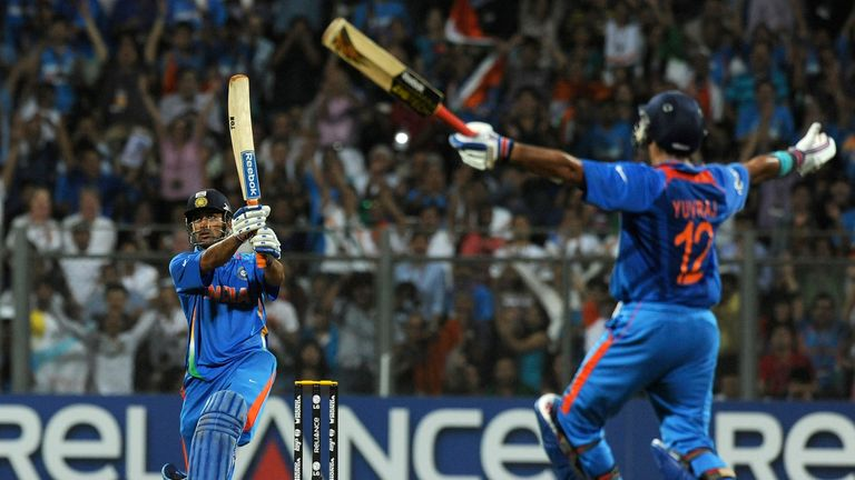 Dhoni (L) smashed six to win the 2011 World Cup for India