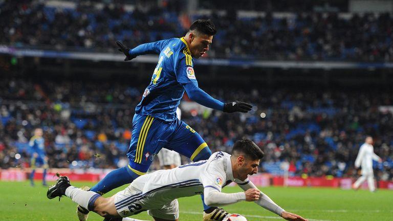 Marco Asensio Is Tackled By Facundo Roncaglia Of Celta Vigo
