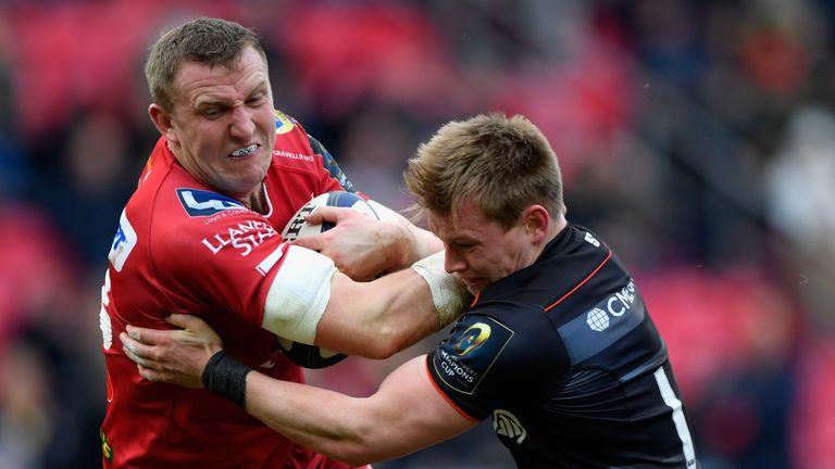 Hadleigh Parkes is tackled by Nick Tompkins of Saracens
