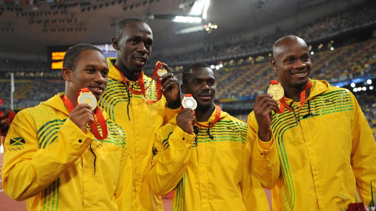 Michael Frater, Asafa Powell, Nesta Carter and Usain Bolt have returned their medals