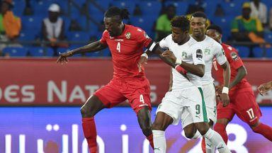 Ivory Coast's forward Wilfried Zaha (right) challenges Togo's forward Emmanuel Adebayor