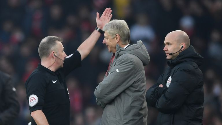 Referee Jonathan Moss orders Arsene Wenger to the stands during the match against Burnley