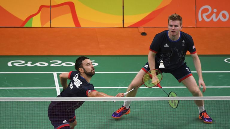 Great Britain's Marcus Ellis (R) and Great Britain's Chris Langridge returns against China's Chai Biao and China's Hong Wei during their men's doubles Bron