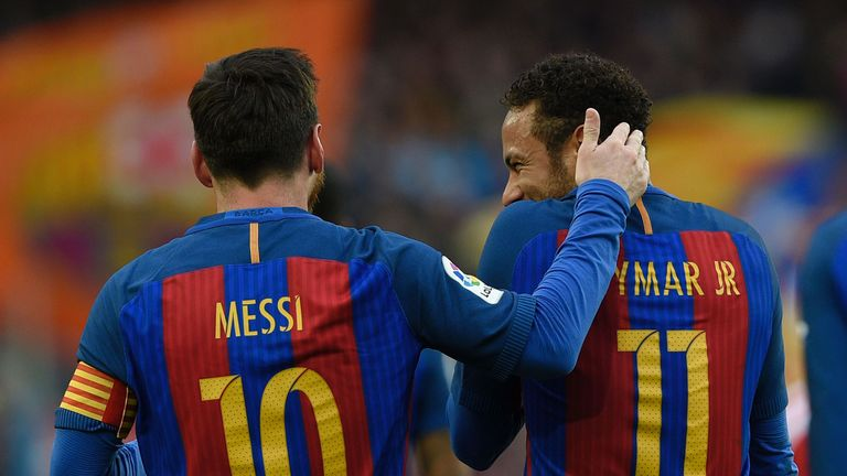 Lionel Messi (left) and Neymar celebrate after the Argentine star made it 2-0 just before the break