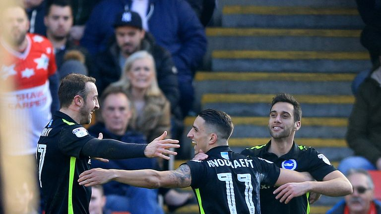 Brighton's Sam Baldock celebrates scoring his side's first goal with Glenn Murray (L) and Anthony Knockaert (C)