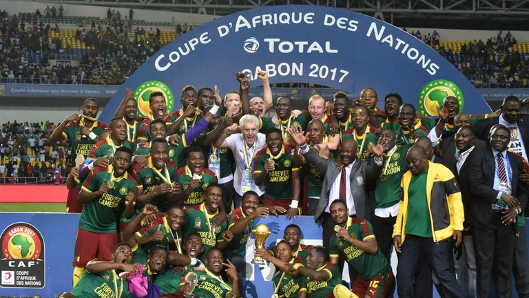 Cameroon celebrate with the trophy